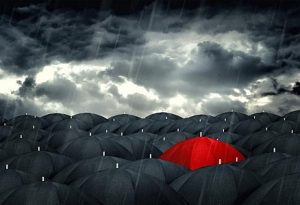red-umbrella-mingling-with-grey-umbrellas-be-different-concept-300x205